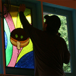 Installing windows for Chuck Franklin Glass Studio at Voodoo Dohnuts